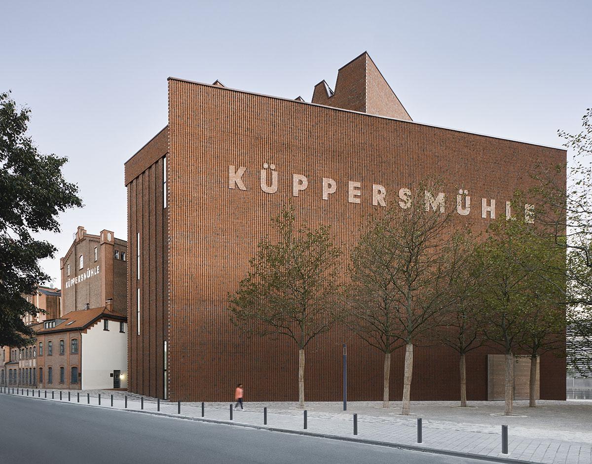 Herzog de Meuron combines brick façade with white cubes for extension of Küppersmühle Museum