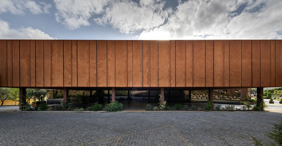 MMVarchitects designs suspended corten steel cultural center in Portugal